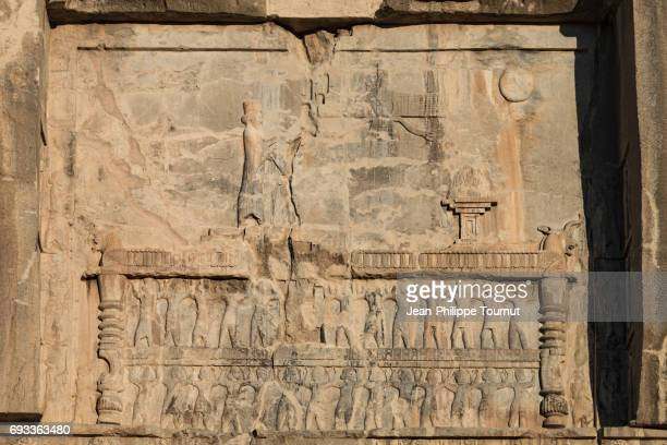 bas relief of the royal tomb of artaxerxes ii mnemon (404bc-358bc) near the ancient city ruins of persepolis, shiraz, fars province, iran - mesopotamian art stock photos and pictures
