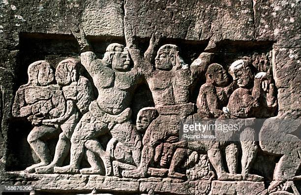 Bas reliefs at the Bayon temple in Angkor Wat. This scene depicts a game of wrestling..