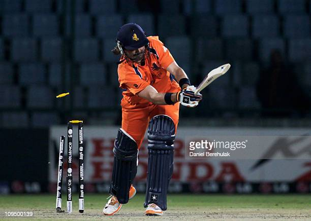 Bas Zuiderent of the Netherlands is bowled by Kemar Roach of West Indies during the 2011 ICC World Cup group B match between Netherlands and West...