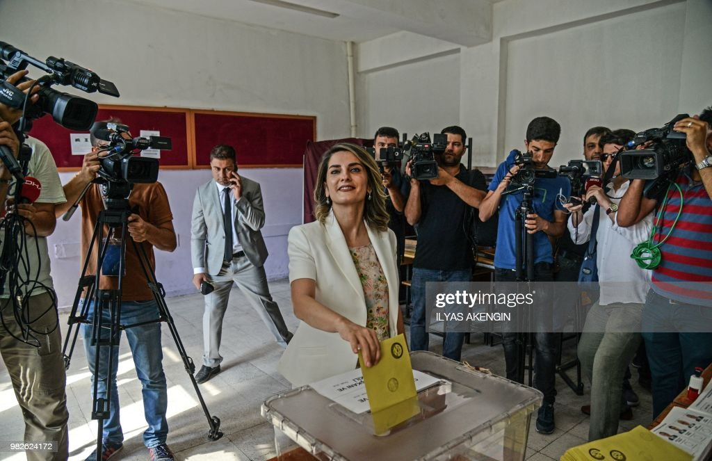 Basak Demirtas, wife of Turkey's jailed pro-Kurdish politician and presidential candidate Selahattin Demirtas votes at a polling station in snap twin Turkish presidential and parliamentary elections in the Kurdish stronghold of Diyarbakir in southeastern Turkey on June 24, 2018. - Turks began voting in dual parliamentary and presidential polls seen as the President's toughest election test, with the opposition revitalised and his popularity at risk from growing economic troubles.