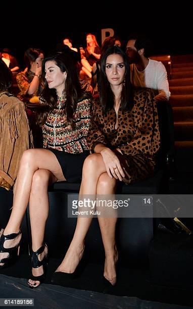 Basak Dizer and Ahu Yagtu attend the Ozgur Masur show for MercedesBenz Fashion Week Istanbul at Zorlu Center on October 12 2016 in Istanbul Turkey