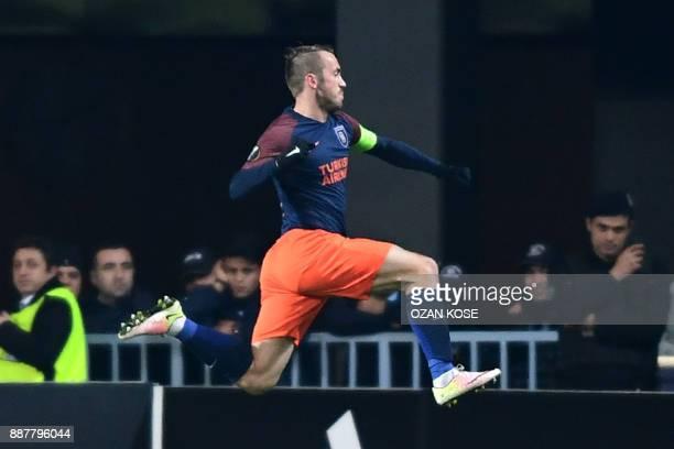 Basaksehir's Bosnian midfielder Edin Visca celebrates after scoring a goal during the UEFA Europa League Group C football match between Istanbul...