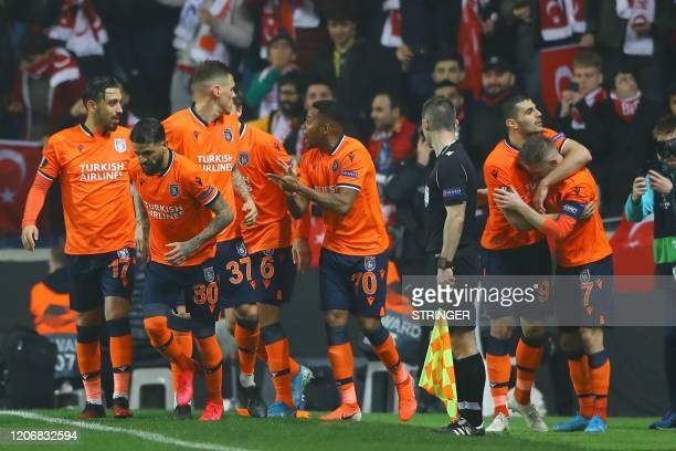Basaksehir's Edin Visca celebrates with his team mates after scoring a goal during the UEFA Europa league last 32 first leg football match between...