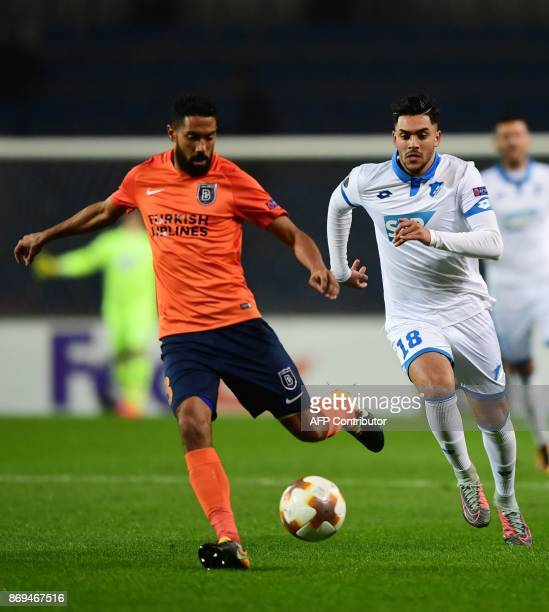 Basaksehir's French defender Gael Clichy vies for the ball with Hoffenheim's Nadiem Amiri during the UEFA Europa League football match Istanbul...
