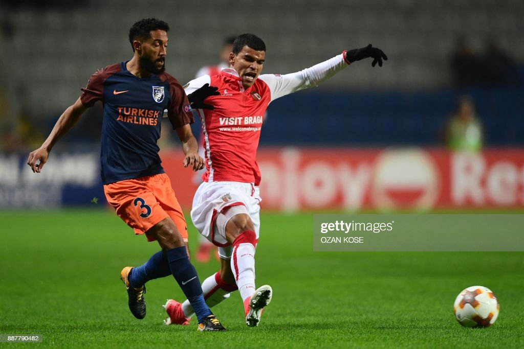 Basaksehir's French defender Gael Clichy (L) vies with Braga's Brazilian midiefler Danilo (R) during the UEFA Europa League Group C football match between Istanbul Basaksehir FK and SC Braga at the Fatih Terim Stadium in Istanbul, on December 7, 2017. /
