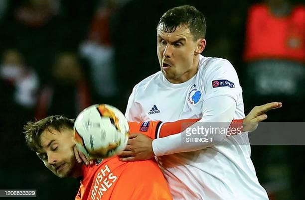 Basaksehir's Serbian defender Danijel Aleksic vies for the ball with FC Copenhagen's Danish defender Andreas Bjelland during the UEFA Europa league...