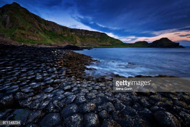 Basalt columns of Giant's Causeway in Northern Ireland at dusk, long exposure