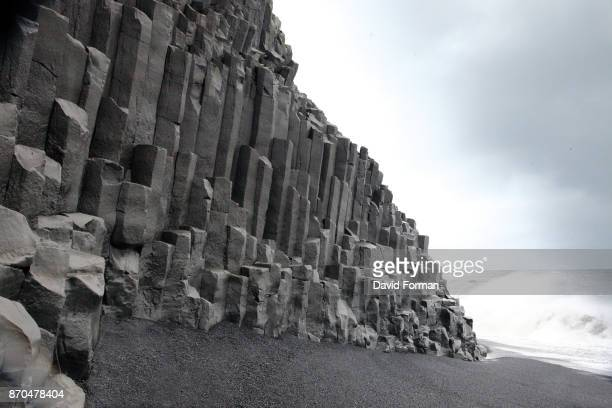 basalt columns on volcanic beach, vik, iceland. - basalt stock pictures, royalty-free photos & images