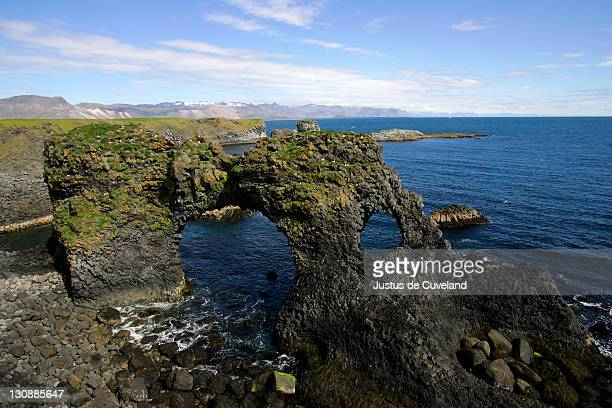 Basalt rock arch at the volcanic cliff coast of Arnarstapi in Iceland - Arnarstapi, Snaefellsnes-peninsula, Iceland, Europe