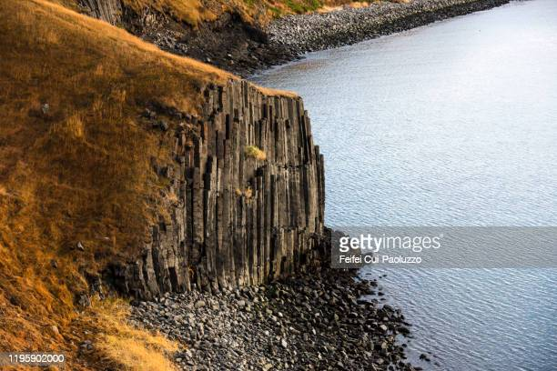basalt rock at bay of skagafjordur, at hofsos, north iceland - rocky coastline stock pictures, royalty-free photos & images