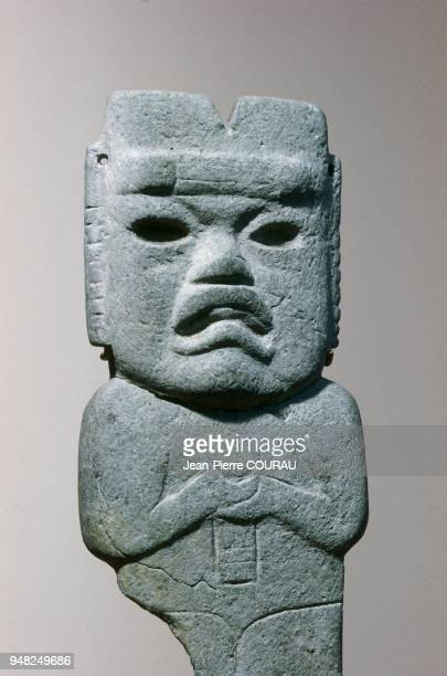 OLMEC basalt votive axe dating from the preClassical period representing a manjaguar and conserved at Mexico's National Museum of Anthropology This...