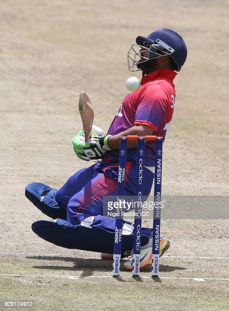 Basant Regmi of Nepal avoids a delivery during the ICC Cricket World Cup Qualifier between Scotland v Nepal at Queens Sports Club on March 8 2018 in...