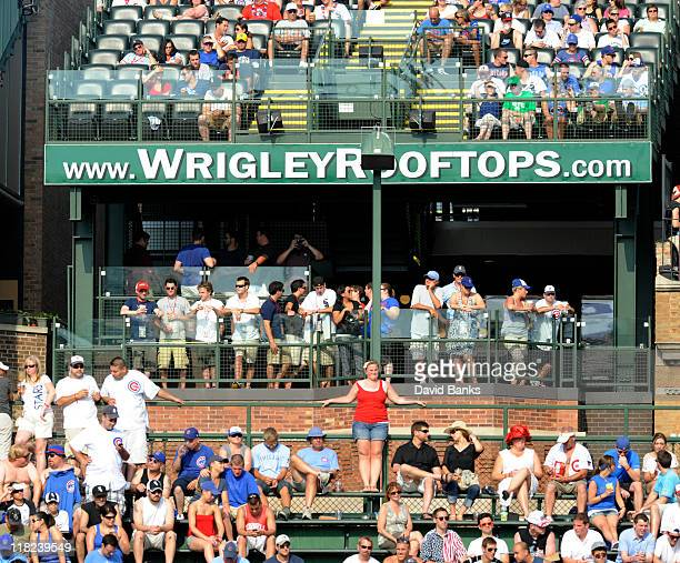 Basball fans sit in the bleachers and rooftops to watch the Chicago White Sox versus the Chicago Cubs on July 2 2011 at Wrigley Field in Chicago...