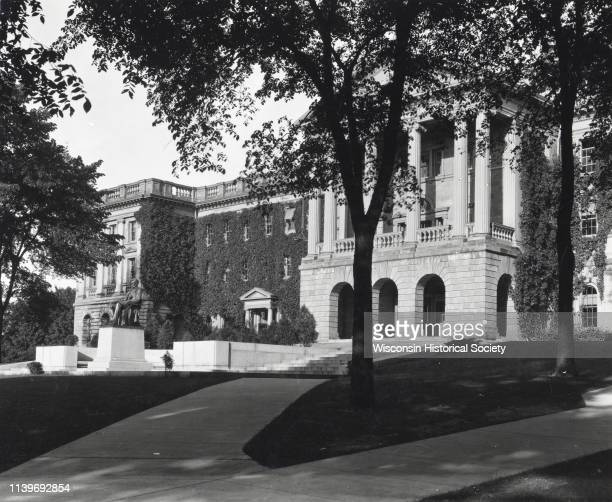 Bascom Hall main entrance on the University of Wisconsin-Madison campus, Madison, Wisconsin, 1922. The Lincoln Monument is on the left. Vines are...