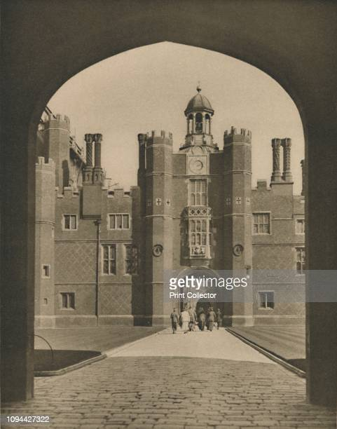 Base Court, the First Quadrangle of Wolsey's Palace', circa 1935. Hampton Court, former royal palace in Richmond upon Thames, London. Started by...