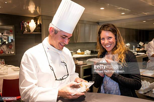 Base jumper and wing suit pioneer Geraldine Fasnacht is photographed for Paris Match with chef Benoit Violier who prepares her specials cakes for her...