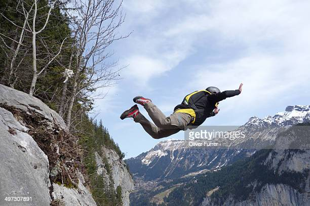 Base jumper exited from a cliff. He must be crazy!
