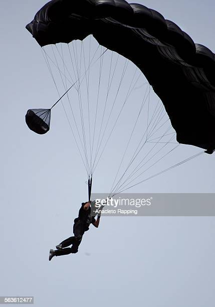 Base jumpers Karin Sako and Jeb Corliss jump off the IB Perrine Bridge in Twin Falls, Idaho . Story to deal eith high–risk, high adrenaline athletes....