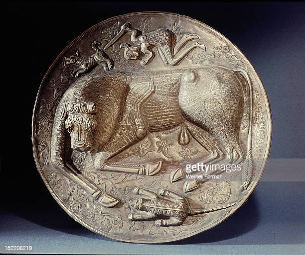 Base of the Gundestrup cauldron The ritual slaying of the bull One of the attacking hounds is lying dead while the warrior is poised to stab the bull...