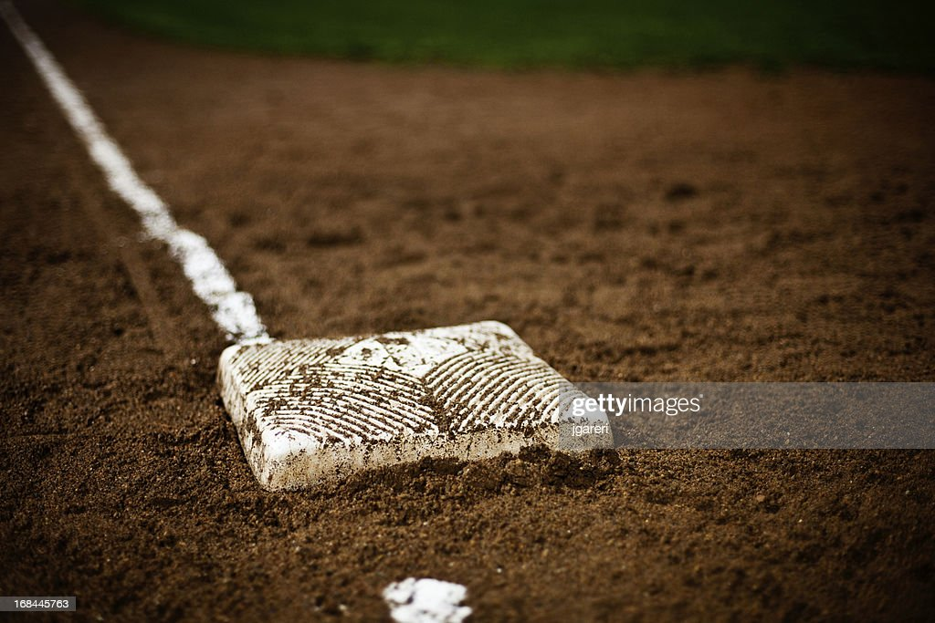 A base on the field in the baseball diamond : Stock Photo