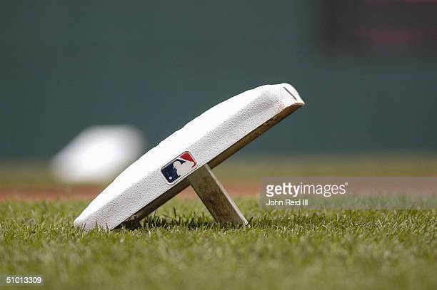 A base rests on the grass before the MLB game between the Cincinnati Reds and the Cleveland Indians on June 13 2004 at Jacobs Field in Cleveland Ohio...