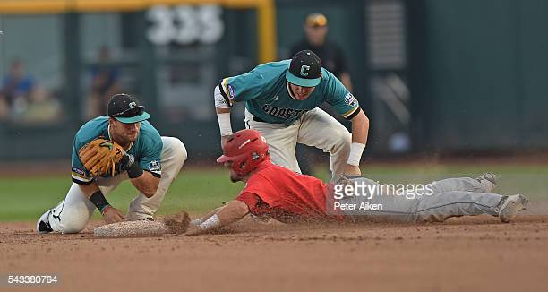 Base runner Cody Ramer of the Arizona Wildcats dives into second base safely against second basemen Tyler Chadwick and Michael Paez of the Coastal...