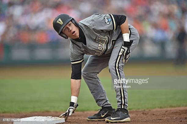 Base runner Jeren Kendall of the Vanderbilt Commodores reacts after getting picked off of first base against the Virginia Cavaliers in the second...