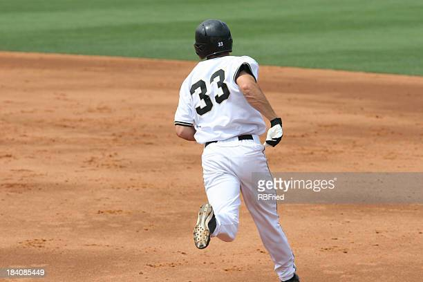 base runner - home run stock pictures, royalty-free photos & images
