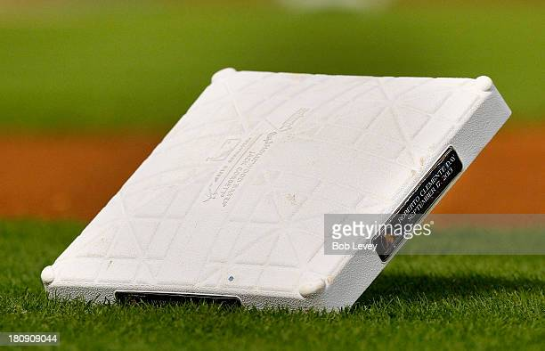 A base with a plaque signifying Roberto Clemente Day sits on the field at Minute Maid Park before the Cincinnati Reds play the Houston Astros on...