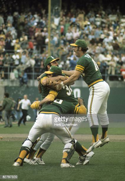 1973 World Series Oakland A's Darold Knowles victorious hugged by teammates after save to win World Series vs New York Mets Game 7 Oakland CA CREDIT...