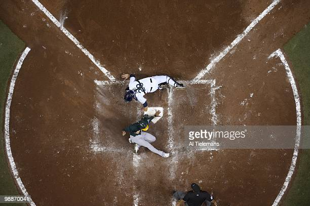 Aerial view of Tampa Bay Rays John Jaso in action tagging out Oakland Athletics Eric Patterson at home plate St Petersburg FL 4/28/2010 CREDIT Al...