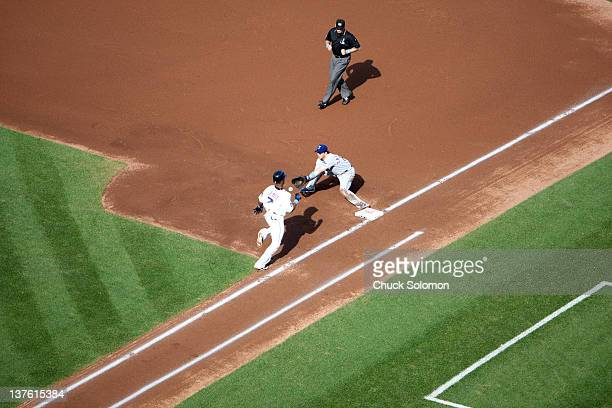 Aerial view of Texas Rangers Frank Catalanotto in action attempting 1st base tag out vs New York Mets Jose Reyes at Shea Stadium Flushing...