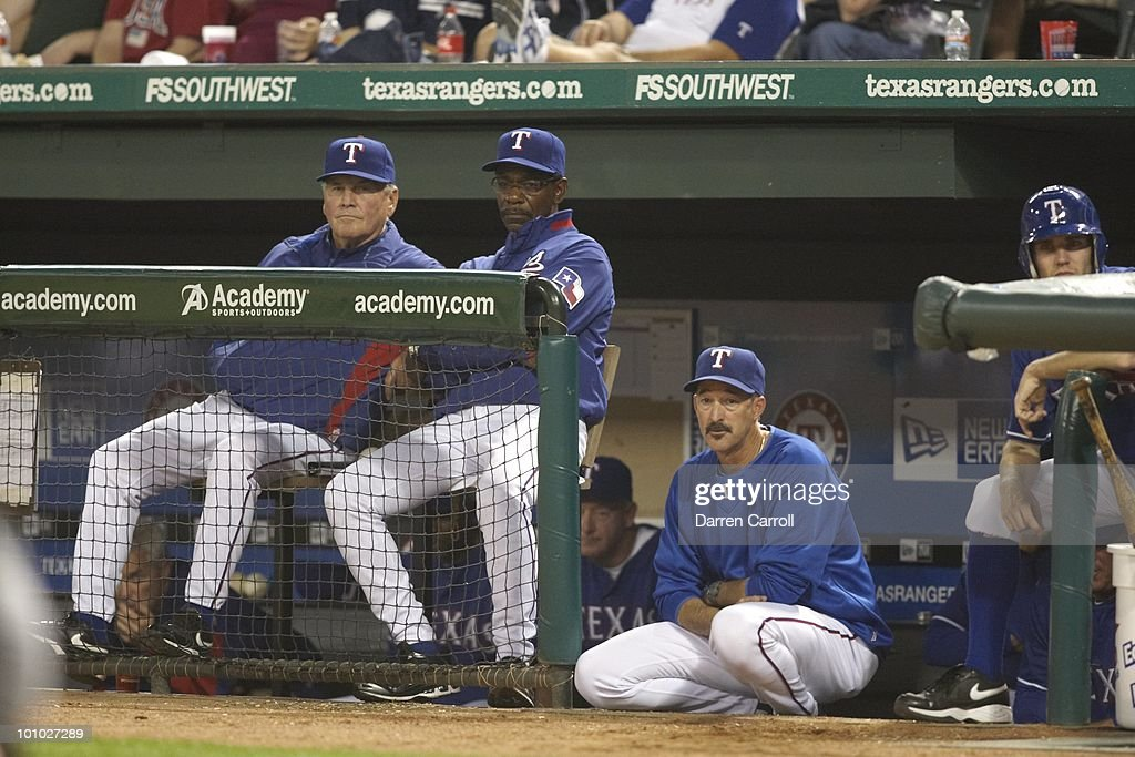 Aerial view of Texas Rangers manager Ron Washington and pitching coach Mike Maddux during game vs Detroit Tigers. Arlington,TX 4/23/2010