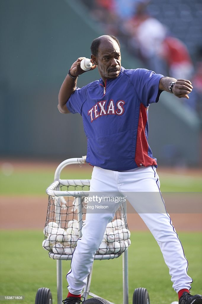 Texas Rangers manager Ron Washington (38) throwing batting practice before game vs Baltimore Orioles at Rangers Ballpark. Greg Nelson F5 )