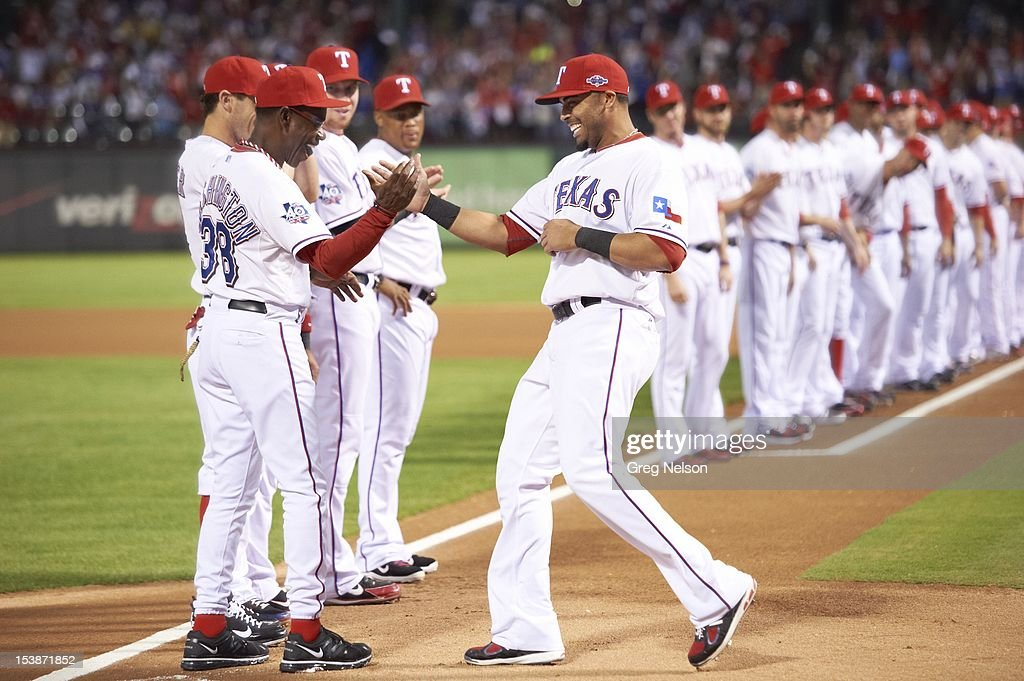 Texas Rangers manager Ron Washington (38) with Nelson Cruz (17) during introductions before game vs Baltimore Orioles at Rangers Ballpark. Greg Nelson F41 )