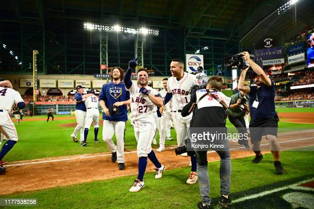ALCS Playoffs Houston Astros Jose Altuve victorious after game winning walkoff home run with Carlos Correa vs New York Yankees at Minute Maid Park...