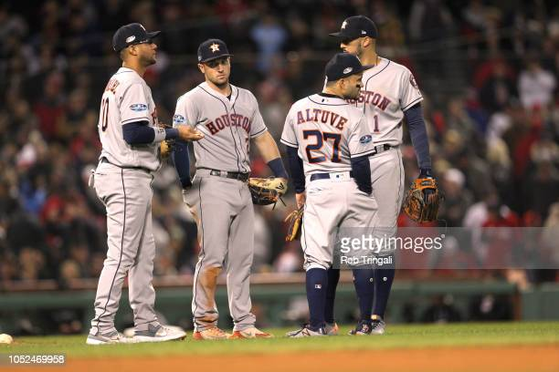 ALCS Playoffs Houston Astros Yuli Gurriel Alex Bregman Jose Altuve and Carlos Correa meeting on field during game vs Boston Red Sox at Fenway Park...