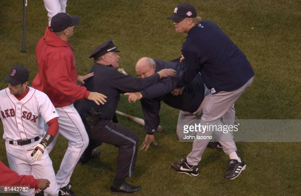 Baseball ALCS Playoffs New York Yankees bench coach Don Zimmer upset getting held by police after fight with Boston Red Sox Pedro Martinez during...