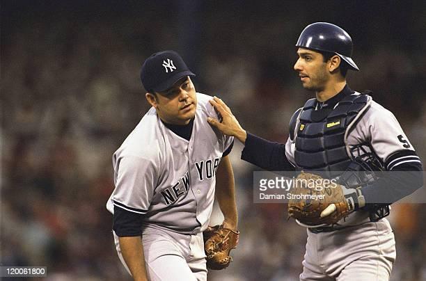 ALCS Playoffs New York Yankees Hideki Irabu on mound talking to Jorge Posada during Game 3 vs Boston Red Sox at Fenway Park Boston MA CREDIT Damian...