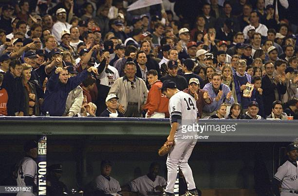 ALCS Playoffs New York Yankees Hideki Irabu walking into dugout after being taken out of Game 3 vs Boston Red Sox at Fenway Park View of fans jeering...