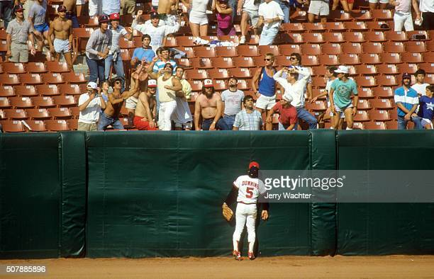 ALCS Playoffs Rear view of California Angels Brian Downing watching ball going over outfield wall for home run vs Boston Red Sox at Anaheim Stadium...