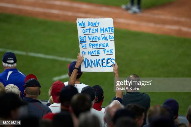 ALDS Playoffs Cleveland Indians fan in stands with sign that reads WE DON'T OFTEN HATE BUT WHEN WE DO WE PREFER TO HATE THE YANKEES during game vs...