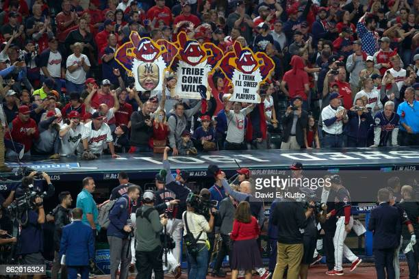 ALDS Playoffs Cleveland Indians fans in stands with signs that read TRIBE GONE WILD and I THINK I'LL SWEEP THE PLAYOFFS during game vs New York...