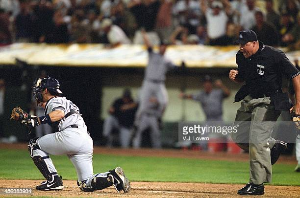 ALDS Playoffs Home plate umpire Kerwin Danley calls Oakland Athletics Jeremy Giambi out after New York Yankees Jorge Posada applies tag during game...
