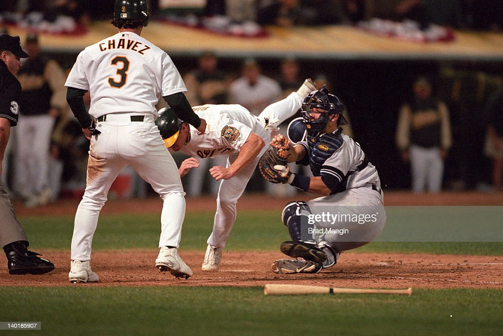 New York Yankees Jorge Posada (20) in action, tagging out Oakland Athletics Jeremy Giambi (7) at home plate at Network Associates Coliseum. Game 1. Brad Mangin X61537 TK1 R13 F26 )