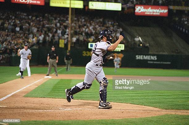 ALDS Playoffs New York Yankees Jorge Posada victorious after flip play from Derek Jeter vs Oakland Athletics Jeremy Giambi at Network Associates...