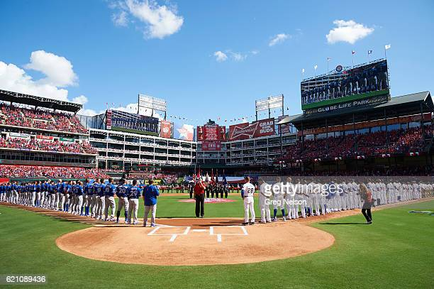ALDS Playoffs Overall view of Toronto Blue Jays and Texas Rangers players lined up on field during player introductions before Game 1 at Globe Life...