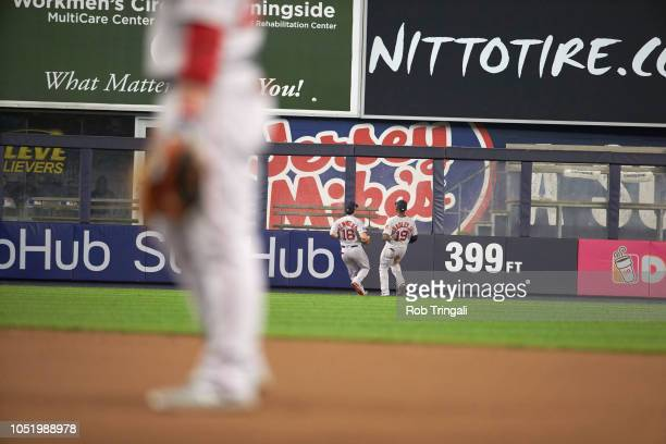 ALDS Playoffs Rear view of Boston Red Sox Jackie Bradley Jr and Andrew Benintendi watching ball go over wall for ground rule double vs New York...