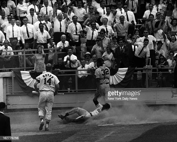 Baseball AllStar Game 1964 Willie is home in a gametying cloud of dust Howard looks at throw from Joe Pepitone it bounced out of control on hard...