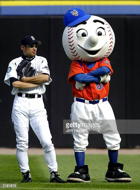 Baseball AllStars Ichiro Suzuki of the Seattle Mariners is mimicked by the New York Mets mascot during batting practice for the 2003 Baseball AllStar...